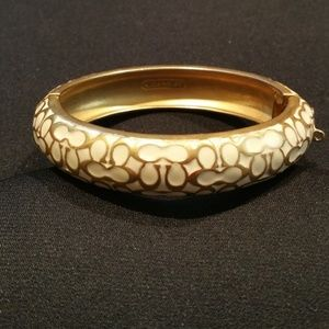 Cream Enameled Gold tone Coach Bracelet